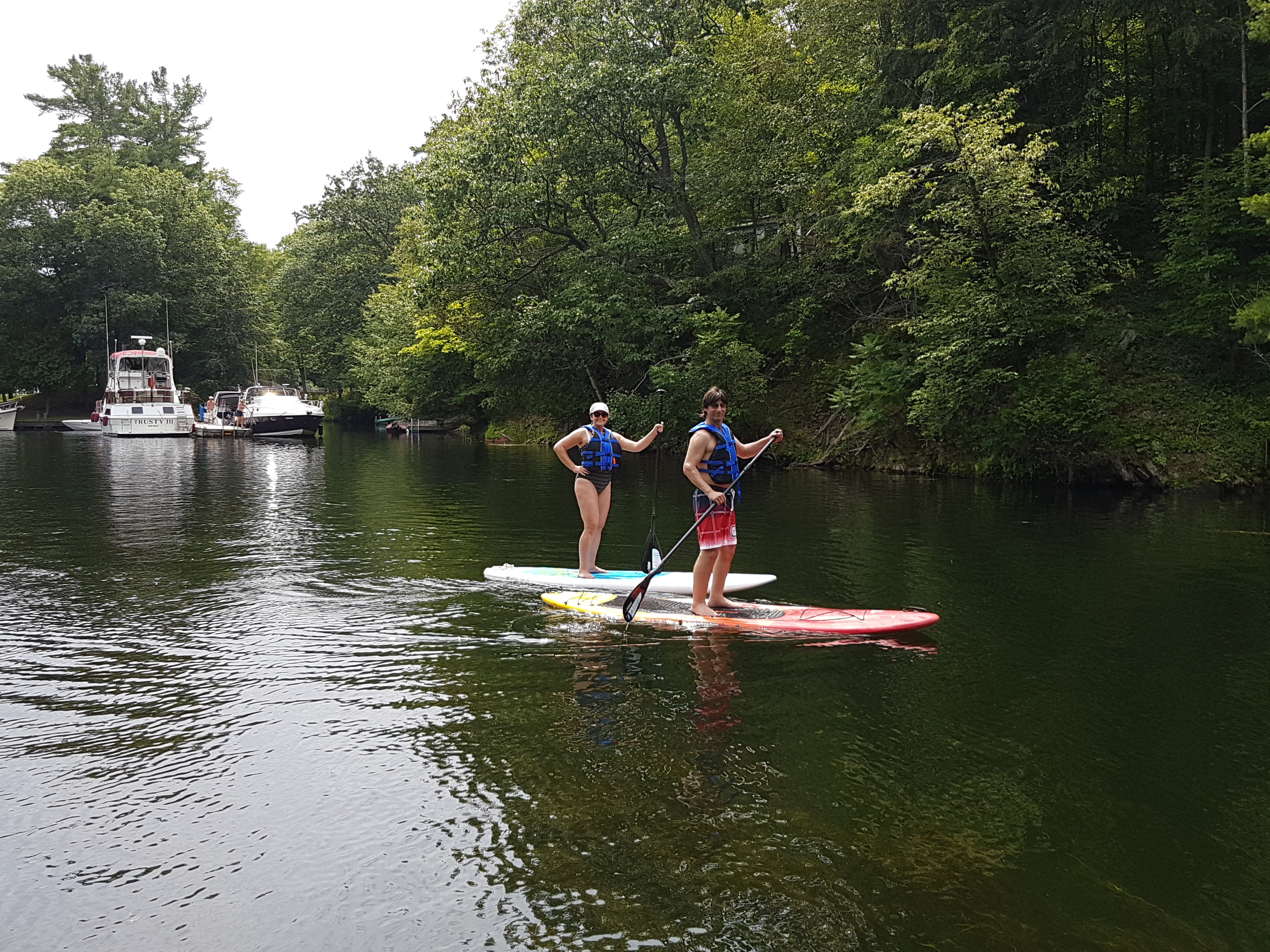 Image of two people on paddle boards.