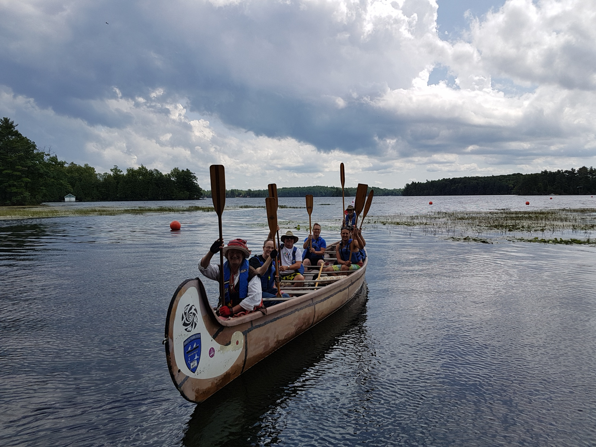 Image of a group of people in a Voyageur Canoe.