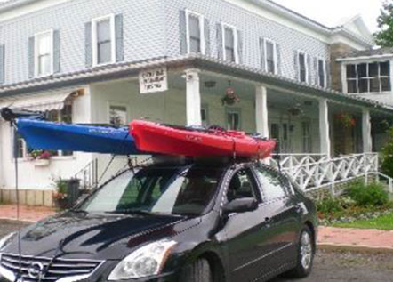 Image of a car with kayaks on top.