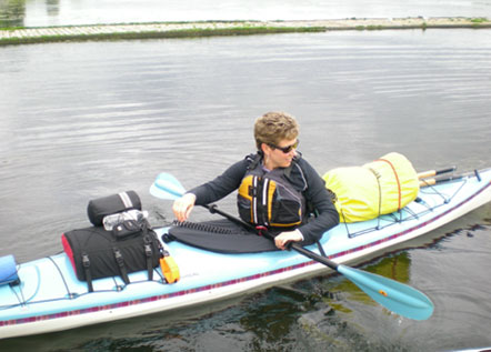 Image of a woman in a kayak.